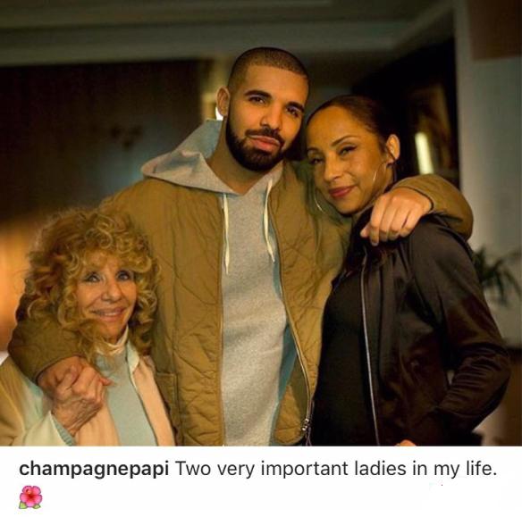 Drake poses with his mum and Sade Adu