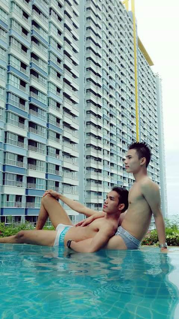 Two thai gay boys enjoying pool