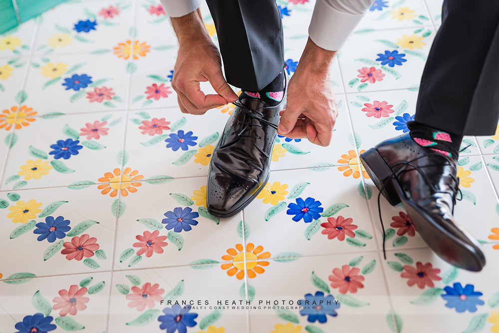 Groom tieing his shoes