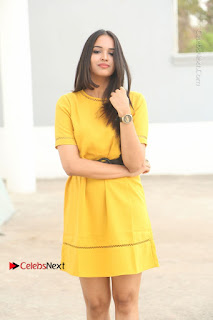 Poojitha Stills in Yellow Short Dress at Darshakudu Movie Teaser Launch