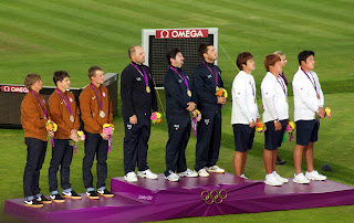 Galiazzo (centre) on the podium after winning the team gold medal at the 2012 London Olympics
