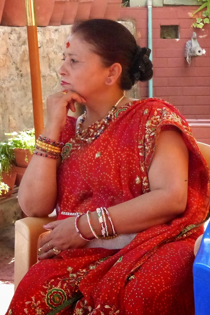 Nepalese woman wearing red sari