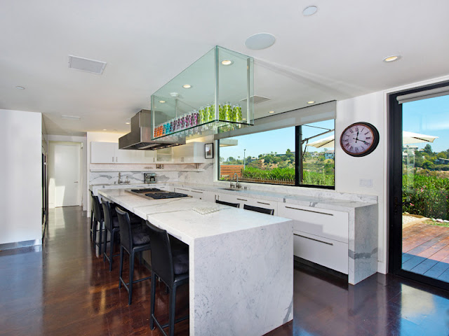 Photo of large kitchen with huge kitchen island in the middle