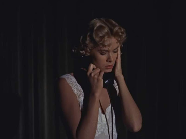 Grace Kelly answering the telephone in Dial M for Murder