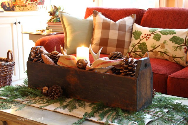 antlers and pinecones in a vintage tool box
