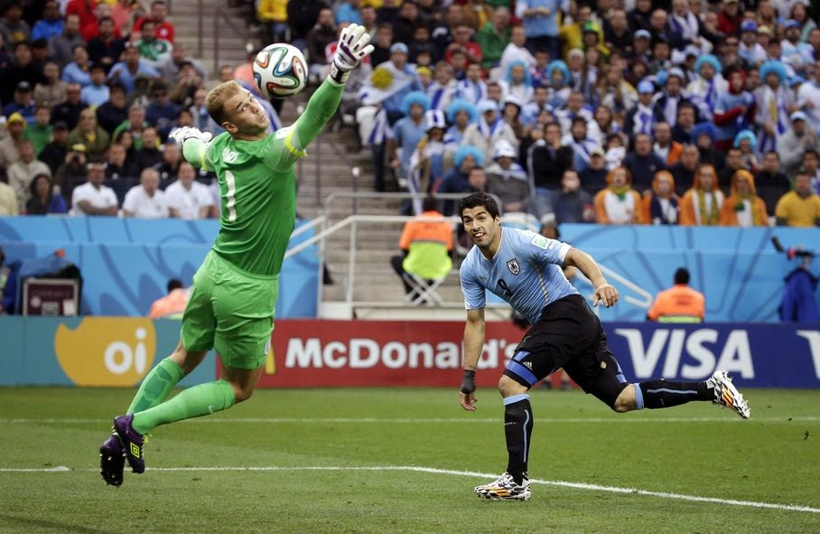 England's goalkeeper Joe Hart can't stop Uruguay's Luis Suarez's header to score his side's first goal during the group D World Cup soccer match between Uruguay and England at the Itaquerao Stadium in Sao Paulo, Brazil, Thursday, June 19, 2014.