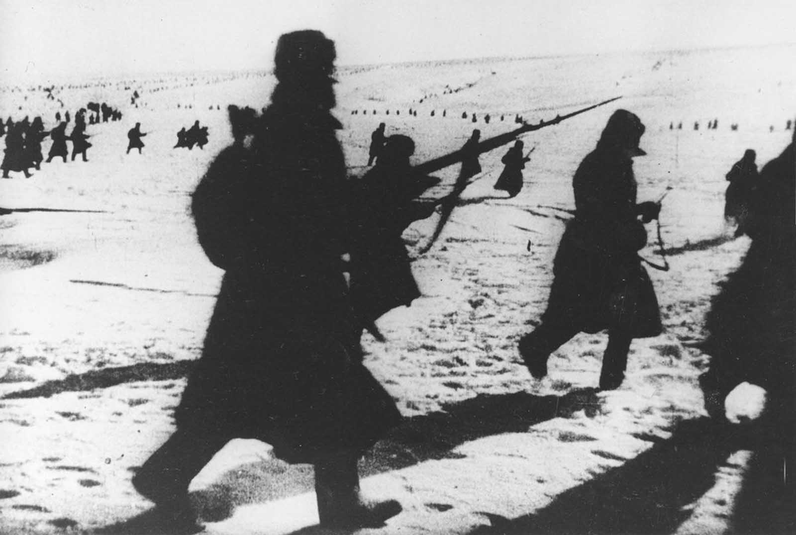 Soviet infantrymen move across snow-covered hills around Stalingrad, on their advance to lift the German siege of the city in early 1943. The Red Army eventually encircled the German Sixth Army, trapping nearly 300,000 German and Romanian soldiers in a narrow pocket.
