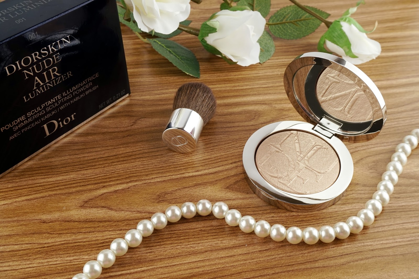 diorskin nude air luminizer shimmering sculpting powder 001 review swatches 1