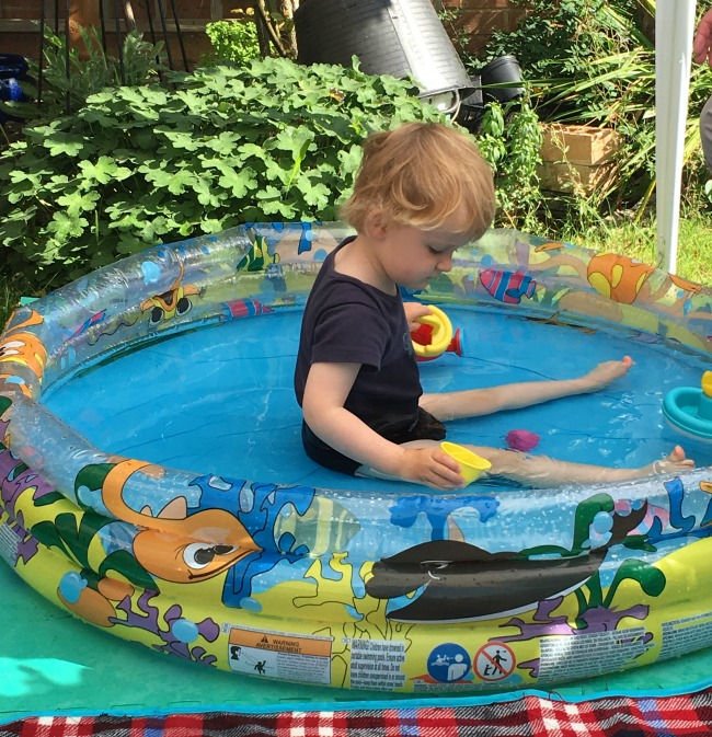 Sunshine-And-Summer-picture-of-toddler-sat-in-paddling-pool
