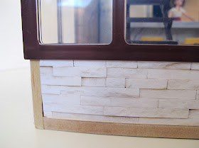 Front edges of the modern Lori Loft to Love dolls' house, showing the raw MDF edges.