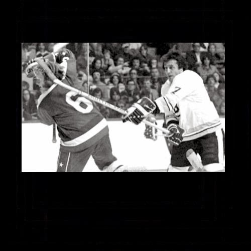 Phil Esposito suggests Gord Smith part his hair                                     on the opposite side
