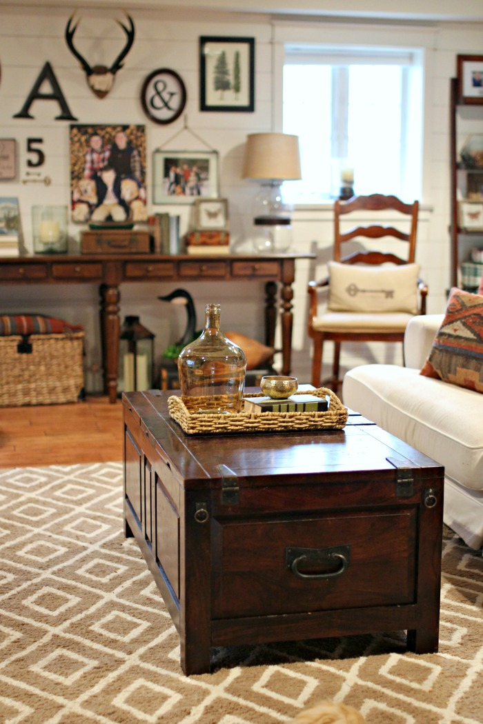 Crate and Barrel trunk style coffee table and Target rug - www.goldenboysandme.com