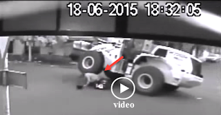 scooter colliding with a loader, loader passes over scooter driver, video