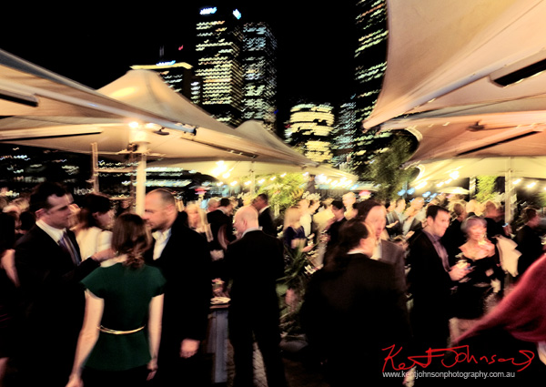 Opening night crowd and the view toward Circular Quay and the city, Cruise Bar re-launch. Photography by Kent Johnson - Street Fashion Sydney.