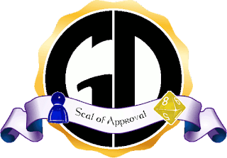 The Game Dork Seal of Approval. The GD-in-a-circle Logo with a gold-leaf style border, with a bluish ribbon across the bottom bearing the words 'Seal of Approval.' The blue meeple and yellow eight-sided die from the Game Dork Logo rest on either side of the ribbon.