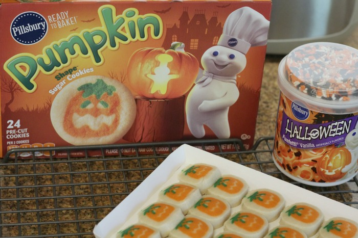 this year i got my kids into the halloween spirit by not just baking them pillsbury ready to bake pumpkin shape sugar cookies but my upping it a notch