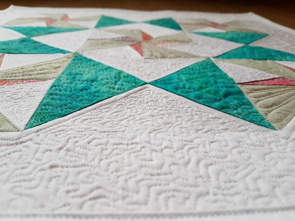Twirling Star mini quilt | DevotedQuilter.blogspot.com
