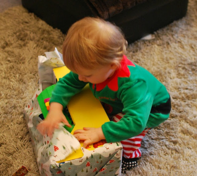 Our-First-Blogging-Christmas-picture-of-toddler-opening-present