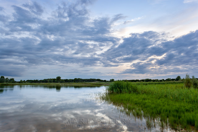 Photograph of sunset reflection at Cambridgeshire nature reserve by Martyn Ferry Photography