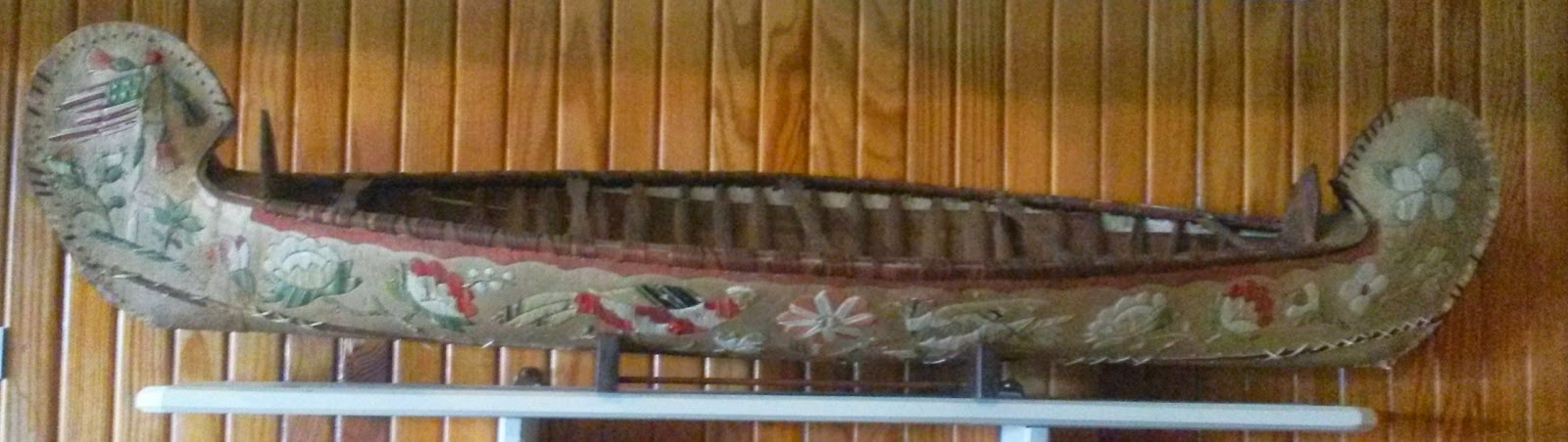 bark model canoe with porcupine quill decoration