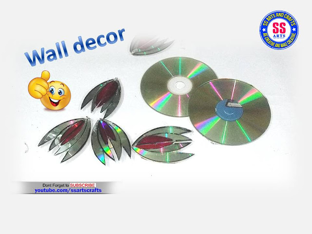 Here is recycled cd wall decor,cd wall hanging,best out of waste cd crafts,art&crafts with recycled cd's,best out of waste with recycled cd wall decor,recycled material craft ideas,cd flower vase,pen stand using cd,cd crafts for kids,how to make things with cd,how to reuse old cd,beautiful showpieces made with recycled cd,home decor ideas using with waste cd,How to make wall decor using recycled cd