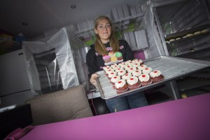 Kastle Sorensen rotates through 100 cupcake recipes at her mobile cupcake cart. (Photo by Ted Kincaid / University of Alaska Anchorage)