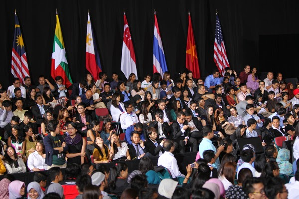 Invited students and almost 150 press corps waited patiently.