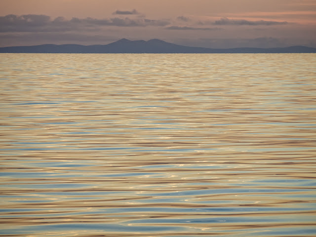 Photo of the Isle of Man from the Solway Firth at sunset