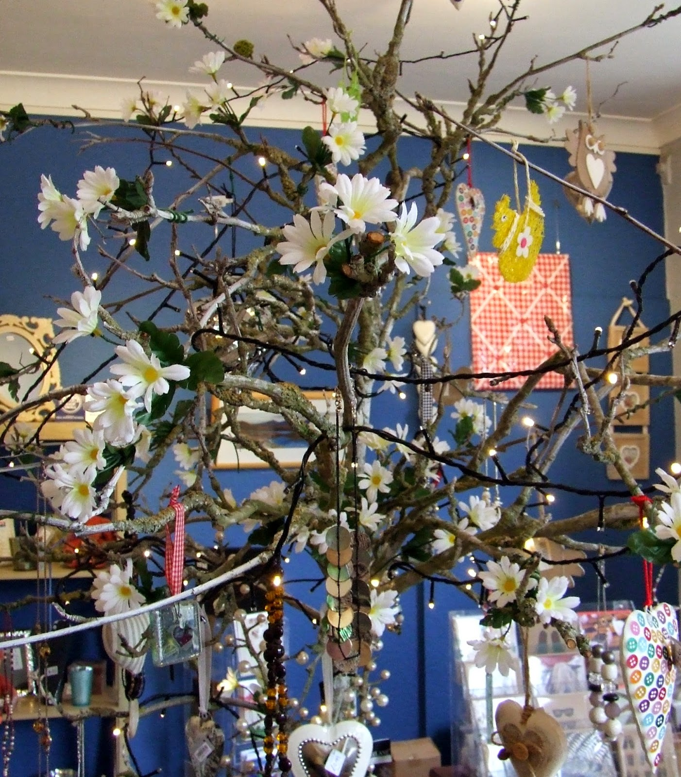 Present Perfect shop tree with blossoms