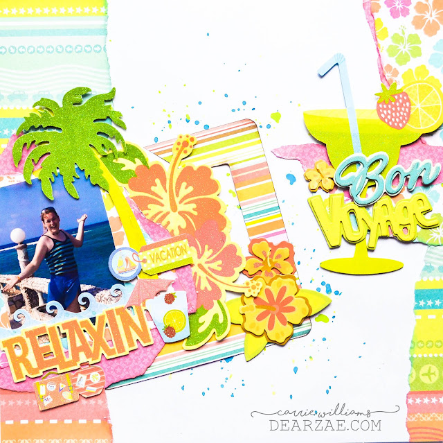 Summer scrapbook page, vacation tropical layout with bright colors and tropical themed die cuts (palm tree, hibiscus, fruit drinks, tickets, suitcases) and mixed media splatter background