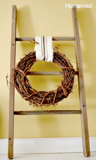 Hang a wreath from DIY grain sack ribbon on a hand made ladder