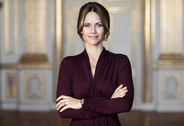 Princess Sofia, Duchess of Värmland celebrates her 35th birthday. Princess Sofia's diamond rings and gol earrings. burgundy silk dress