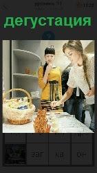 на кухне происходит дегустация приготовленной еды на столе