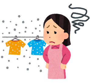 空気の汚れに悩む洗濯物を干す人のイラスト(埃・PM2.5)