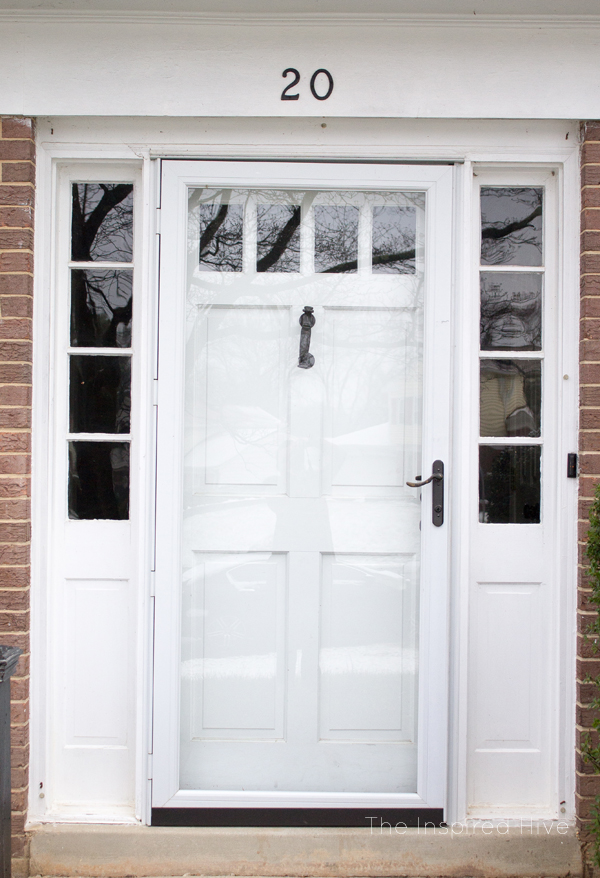 White exterior door with sidelights