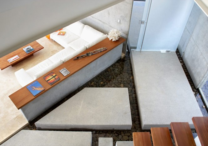 The four bedrooms in the house the hallway creates the allusion of stepping stones canas used concrete here because its a great minimalist material