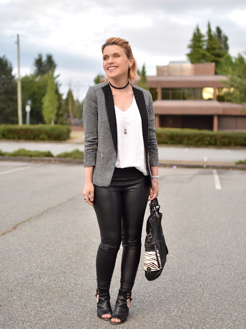 styling a shawl collar blazer with faux-leather leggings, a slouchy white tee, and cut-out booties