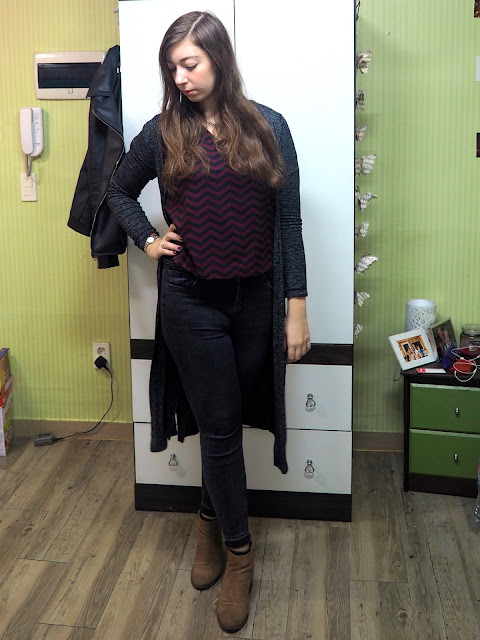 Zig Zag - outfit of long grey cardigan, black and purple bold print top, grey skinny jeans and brown ankle boots