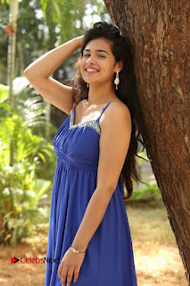 Actress Prasanna Stills in Blue Short Dress at Inkenti Nuvve Cheppu Movie Platinum Disc Function  0079.JPG