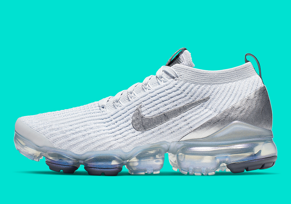 c2c34f45863d Small pops of dark grey also appear on the tongue heel tabs for a  just-right dash of detailing. A crystal-clear VaporMax cushioning unit with  the smallest ...