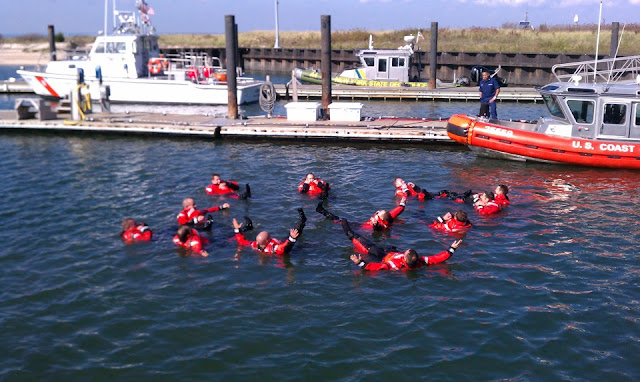 Regular and Reserve personnel at USCG Station Eatons Neck during cold weather immersion quals.