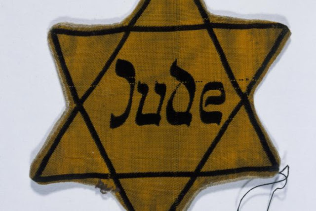 25 October 1939 worldwartwo.filminspector.com Yellow star of David badge