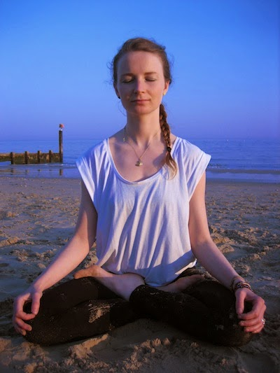 Melissa in lotus pose on Bournemouth beach