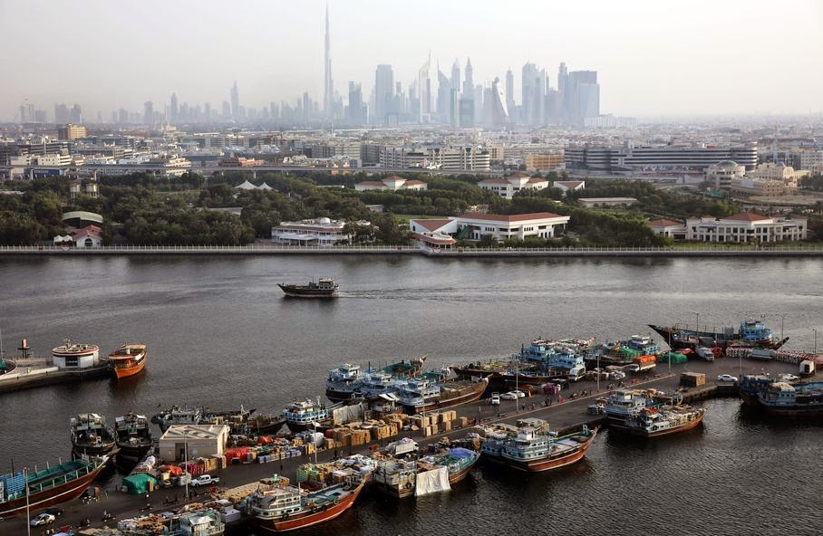 This Monday, May 26, 2014 photo, shows abra taxi boats leaving their station in Bur Dubai to take passengers to Deira in Dubai, United Arab Emirates. From early morning to late evening the creek is abuzz with daily commuters and tourists riding in abras, the wooden boats that have been used for more than a century and are still built by hand nearby. The 25-cent passage from one bank to the other is one of the only bargains left in a city where much of the population is expatriates lured to the Gulf emirate by job opportunities.
