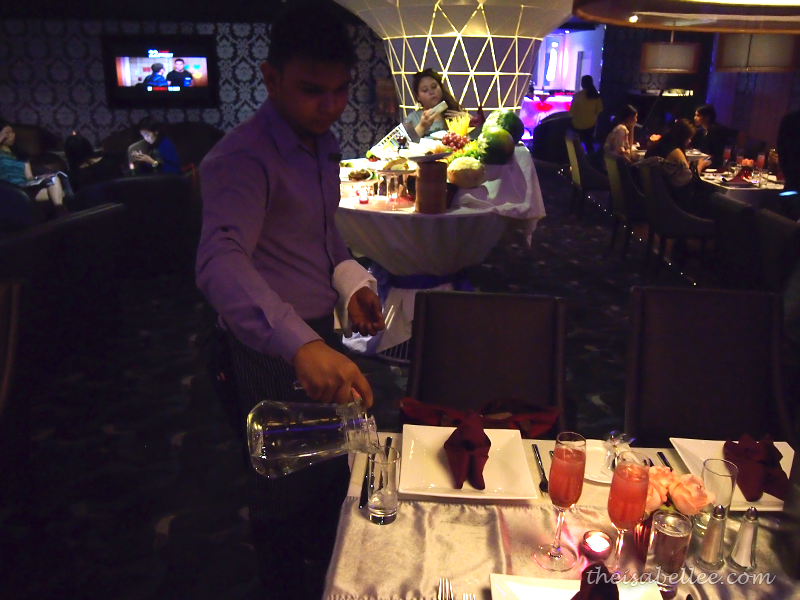 Waiter pouring drinks at TGV Indulge