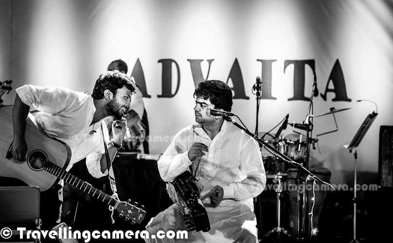 On 23rd September' 2012, ADVAITA was celebrating it's 8th Birthday ay India Habitat Centre in Lodhi Estate, Delhi. Since I was also in town, so thought of visiting the place to enjoy music with ADVAITA & some of the artists from MRIGYA & PARIKRAMA. This Photo Journey shares some of the musical moments of ADVIATA Performances at IHC, Delhi...Chayan Adhikari & Suhail Yusuf Khan talking to each other during the performance..Aman Singh Rathore on Drums !This musical event had to start at 6pm in open Amphitheater of IHC, but as per Delhi trends it started after 7pm. Since weather was good, it was fine with music lovers sitting there. Whole space was full and people were finding space on surrounding walls. For finding a place to sit, many of the IHC plants were destroyed. It was really sad to see people acting so cruelly with plants around AmphitheaterSuhail Yusuf Khan was playing Sarangi during most of the performances and sang some classical numbers in between. He was awesome at both the things.Then whole team of ADVAITA came on stage and thanked everyone to come & wait for them. It started with good mood and nice songs. ADVAITA is an eclectic music group from New Delhi, India. ADVAITA team borrowed their name from an ancient Indian philosophy, which translates to mean Non-Duality. Ujwal Nagar, The Classical Vocalist of ADVAITA was star of the evening for me. He was awesome and best at his role in the crew. Loved the way he sings and especially his performance in Ghir-Ghir... He looked like a shy personality, some of us were talking about the same :Surojeet Dev on Drums, while Prithveesh Dev was singing on the stage !Some guest performers were also invited during the evening. Nikhil Mawkin Nikhil Mawkin is a well known name in the music circuit in Delhi. He has made his mark in the music circuit with bands like Mawkin Revival and Cuenta Cuentos. Mawkin has a flair for bringing together different genres of music and blending them to create a sound that is unique. Last evening he performed one song with Prithveesh Dev & Chayan Adhikari Since ADVIATA Music  group was formed, it has steadily grown to become one of the most respected acts on the Indian music scene. Their sound is a melange of the styles, moods and textures they have taken in from different cultures and different music systems of the world. Their exploration of music is something that keep them going and it a very good way. Their fans across the country are loving the way they experiments with Musical fusion and the team is best at itPrithveesh Dev at IHC, Delhi (INDIA)Sharad Chandra Shrivastava of MRIGYA and Abhishek Mathur of ADVAITA on right Sharat is one of the founding members of MRIGYA Band and the driving force behind the band. Over the years, he has been instrumental in leading the direction of the music of Mrigya. As the violin maestro, he is considered to be one of the best young violinists in the country. Owing allegiance to the Senia Gharana, he has been extremely active on the performing circuit for over 2 decades. His nascent talent, nurtured since age 7 by the renowned violinist Late Pandit Joi Srivastava, his Guru and grandfather, has lent him rare understanding of the 'Dhrupad-Ang', a style unique to this Gharana under the Guru-Shishya parampara. This and such grooming has put him on stage with the likes of Ustad Amjad Ali Khan, Pt. Hari Prasad Chaurasia, Pt. Birju Maharaj. As an acclaimed soloist, he was selected for the Sahitya Kala Parishad's coveted 'Yuva Mahotsava'. Sharad has also performed with a certain Mr. Gordon Sumner aka 'Sting' apart from playing with the acclaimed Indian rock band Parikrama for over a decade Check out more about Mrigya Members at http://www.mrigya.com/members.htmSukriti Sen performing with Advaita at IHC, Delhi. She is an Indian classical vocalist who has over the years lent her voice to countless jingles and classical performances. Sukriti adds her own interpretations of vocal techniques which adds magic to any composition.  She has performed across the world and is now a seasoned vocalist to boot. She also toured with Pete Lockett (the renowned precussionist) in India along with Selvaganesh (Shakti & Mclaughlin).More at - http://www.mrigya.com/members.htmAlthough there were many technical and administrative glitches, but audience was really enjoying the performances. Administrative glitches can be because of the nature of program. Many guest performers were invited and each of them needed specialized setup & time as well. But all of that was very well handled. During one of the gaps Chayan asked a boy to come on stage, who had come with a cardboard saying 'Happy Birthday Advaita'. ADVAITA believes in oneness and spirituality of music. 8 member psychedelic fusion band combines human emotions with the context of the universe, the Brahman and the spiritual. They are Advaits as unlike bands which consist of 4 or at the max 5 members they are an EIGHT member band. And it was a great gesture of calling other band members and sharing same platform to perform in front of Music Lovers of Delhi !Since the inception of Delhi based eclectic fusion band, Advaita, it has gained lot of respect in the Indian music scenario. (For folks who are unfamiliar with this fusion genre – a fusion genre is a music genre which combines two or more genres. The main characteristics of fusion genres are variations in tempo, rhythm and sometimes the use of long musical 'journeys' that can be divided into smaller parts, each with their own dynamics, style and tempo. A word 'fusion' used alone often refers to jazz fusion.)ADVAITA Team is made up of following artists -  Chayan Adhikari – Vocals, Acoustic Guitars    Ujwal Nagar – Classical Vocals    Aman Singh Rathore – Drums    Anindo Bose – Keyboards & Electronics    Suhail Yusuf Khan – Sarangi & Classical Vocals    Abhishek Mathur – Electric Guitars, Electronics    Gaurav Chintamani – Bass Guitar    Mohit Lal – Tabla, Bols, PercussionSuchet Malhotra who was playing with different musical instruments to create different sounds..Tarun BalanAditya Balani  - Name ADVAITA is suggested by him onlyRajat Prasanna - Flute Ashhar Farooqui - Third Last SongArpan Guha Thakurta, who joined the stage with ADVAITA folks for few performances ! This frame was captured during the end of this show.. Event was concluded with a fantastic performances by ADVAITA at around 10:10 pm and everyone at IHC was standing and enjoying the music with some slaps  Advaita is an 8 member fusion band from New Delhi(INDIA), which was formed in 2004. The band features Abhishek Mathur (guitars), Aman Singh (drums), Anindo Bose (keyboards), Chayan Adhikari (vocals, guitars), Gaurav Chintamani (bass), Mohit Lal (tabla), Suhail Yusuf Khan (sarangi), and Ujwal Nagar (vocals). They bring together Indian classical sensibilities with orthodox rock arrangements. In March 2009, they released their debut album Grounded In Space with EMI Records. The band has also recorded two tracks for the India Soundpad compilation which was produced by top British producer John Leckie and released under Counter Culture Records. In 2012, they released their second album The Silent Sea, also on EMI Records.Whole event was quite engaging and next two photographs shows the way crowd is enjoying the music with full involvement. As mentioned by  Prithveesh Dev, towards the end Music was literally flowing in the bloodA view of ADVAITA performing in open Amphitheater of  India Habitat Centre, in front of energetic audience. This Photograph is showing the kind of musical energy, which was flowing during 23rd evening @ IHC, Delhi Big thanks for Ankur Prakash, for letting me know about this event and sharing appropriate details while writing this Blog-post