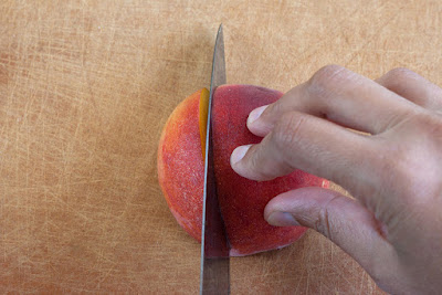 Slicing a peach lengthwise