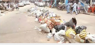 Uproar As Refuse Takes Over The Street Of Akure