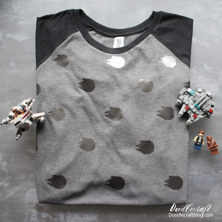 Gray and Black raglan shirt with pewter Millenium falcons all over it arranged like polka dots