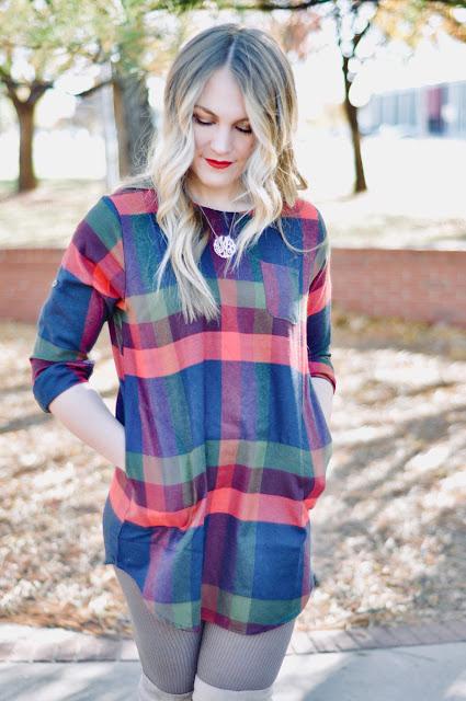 blonde woman wearing plaid dress